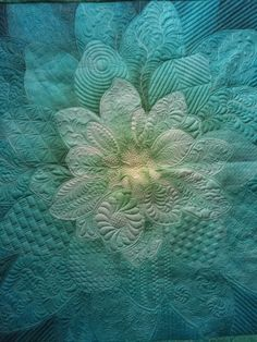 Harriet Carpanini, HandiQuilter instructor, used a few Ultimate Background stencils on a Hoffman panel. Machine Quilting Designs, Quilting Ideas, Fabric Panel Quilts, Free Motion Quilting, Longarm Quilting, Whole Cloth Quilts, Quilt Modernen, Flower Quilts, Landscape Quilts