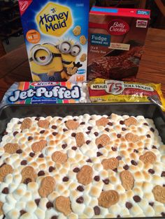 Minion Smores Brownies- Bake according to box, then cover w/ miniature marshmallows,  sprinkle w/ Honey Graham minion cookies & chocolate chips. Broil for a minute or two lightly toast the marshmallows. Kickin' it up a notch for those ya love!