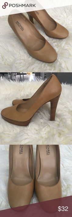 Michael Kors Tan Beige Round Toe Thick Heel Pump Gently used. Heel portion is in perfect condition. Leather has some minor smudging and scratches. Nothing noticeable while wearing. No dents cuts or scraps.  See pics. MICHAEL Michael Kors Shoes Heels