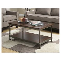 The Office Star OSP Designs Sullivan Coffee Table is as functional as it is classic. It's given a traditional feel with the rustic design and double shelf that will compliment the other pieces of furniture in your living room. Place a stunning bouquet of flowers, coasters and magazines on the walnut wood finished cocktail table to set the tone of your living room. It's a fabulous choice for any home.