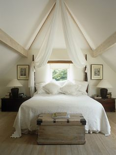 Country Living... Love this room, especially the drapes from the high ceiling