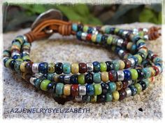 BEADED WRAP BRACELET/ BOHO SEED BEAD LEATHER WRAP BRACELET/ BEADED LEATHER WRAP/ BOHEMIAN LEATHER AND SEED BEAD WRAP BRACELET/ MULTI-COLOR. YOU HAVE YOUR CHOICE OF MANY BUTTONS. IF THERES AN ITEM WITH A PARTICULAR BUTTON YOUD LIKE ON ANOTHER LEATHER WRAP BRACELET, PLEASE LET ME