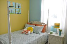 Love the yellow/blue walls for a little girl's room.