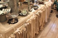 tied muslin and burlap table skirt...LUV!!!