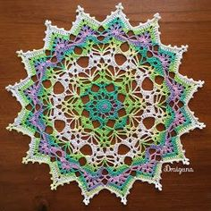 "This doily is 18 rounds and measures about 10 1/2"".  I used Alize Miss Batik thread in the colorway 3708.       Materi..."