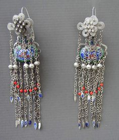 Pair of antique silver and enamel earrings from Tu People, North-East Qinghai and plateau of Tibet.  | At least 100 years old ( Quing period ). | Made up with two elements, the lower embellished ( on both sides ) with blue, green and red enamel. The pendants and the beautiful chains give an impression of lightness