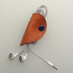Leather earbud / earphone / cable organizer in tan vegetable tanned leather, handmade by RinartsAtelier,