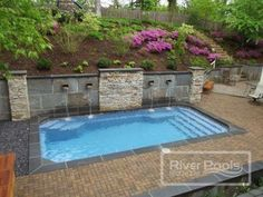 You want to be a pool owner, but where do you start? We tell you your first steps to getting a swimming pool as part of our ultimate pool planning guide. Inground Pool Designs, Semi Inground Pools, Swimming Pool Designs, Small Inground Pool, Sloped Yard, Sloped Backyard, Backyard Pool Landscaping, Small Backyard Pools, Acreage Landscaping