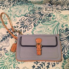 Coach wristlet Coach wristlet in EUC. Pale blue with tan leather and buckle. Magnetic snap compartment in front, along with main zipper compartment. Kelly green lining. So pretty and unique!! Coach Bags Clutches & Wristlets