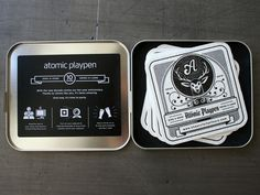 _0001_atomic_playpen_coasters_metal_case_inside