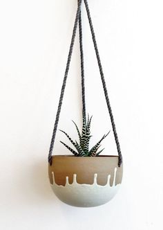 Small ceramic hanging planter.