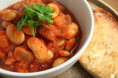 Healthy tomato and butter bean stew - The National Greek Recipes, Pork Recipes, Vegetarian Recipes, Cooking Recipes, Savoury Recipes, Good Food, Yummy Food, Yummy Yummy, Bean Stew