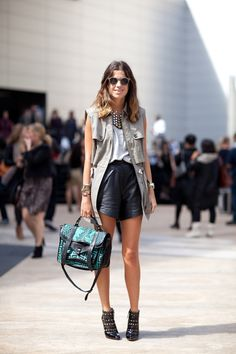 utility vest + leather shorts on The Man Repeller