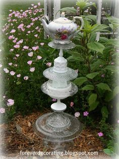 Handmade Garden Art - a little fancy for my tastes - but using tin objects would be cool