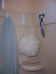 I love 3-M Command hooks.  I have them all over the house!  They even hold up in the shower!