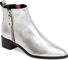 Dolce Vita Women's Shoes in Silver Leather Color. A minimalist profile and mid, stacked heel underscore the street attitude of a versatile bootie that deftly spans the seasons. #shoes #footwear #fashion #style #stylish Minimalist Shoes, Silver Shoes, Pumps, Heels, Silver Color, Women's Shoes, Attitude, Footwear, Profile
