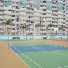 Image from a series of sports fields in urban environments.