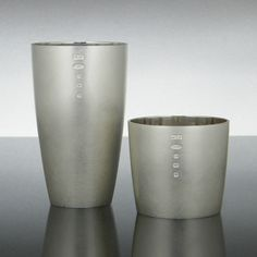 Martyn Pugh - Crafts Council. Simple drinking vessels with subtle, comfortable curves that sit well in the hand. With a matt, white exterior that resists finger prints and a highly polished interior to reflect the contents.