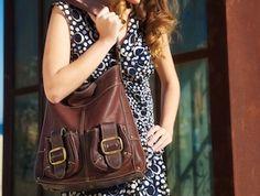 A woman enjoying one of our designer bags Coach Outlet Store, Laptop Messenger Bags, Designer Bags, Women's Bags, Woman, Stylish, Couture Bags, Women, Women's Handbags