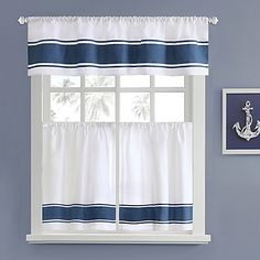 Add a nautical touch of style with the Harbor House Sailor Window Curtain Tier Pair. This attractive tier pair features nautical-inspired, blue bands. Perfect for a kitchen, bathroom and more. Coordinate with the matching valance (sold separately).