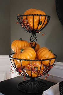 I have a very similar fruit basket. This will look so decorative in the fall. I really like how the berry sprigs were added to the display of mini pumpkins.