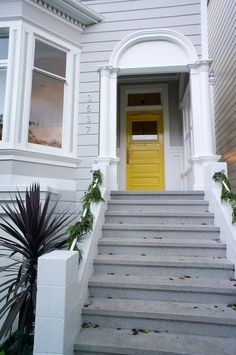 Name: Brad, Julie and Rye OlcottLocation: Dolores Heights, San Francisco… Grey Houses, Yellow Houses, Old Houses, Modern Victorian Homes, Victorian House, Outside House Colors, House Exterior Color Schemes, Yellow Front Doors, Craftsman Door