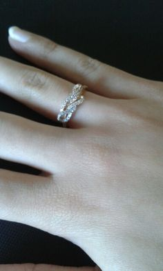 fragile, petit gold ring/ beautiful/ with hint of rose gold and hint of sliver shine within the studs