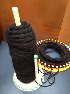 Use a paper towel holder to put yarn on and be able to use both ends of the yarn for 2-string loom knitting with no hassle.