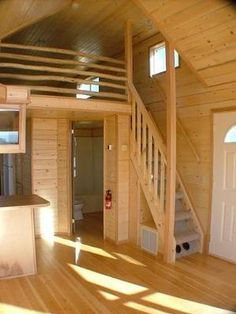 The railing and stairs to the loft in this tiny house are steep, but look sturdy. I'd swap out my ladder for this any day! (image only) | Tiny Homes
