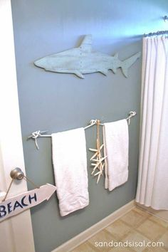 Shark bathroom accessories can be applied in creative ideas of wall arts. shark bathroom accessories of rustic or shabby wooden shark arts, shark hooks, shark Shark Bathroom, Beach House Bathroom, Beach Bathrooms, Beach House Decor, Home Decor, Sea Bathroom Decor, Bathroom Wall, Beach Theme Bathroom, Boho Bathroom