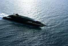 BLACK SWAN SUPERYACHT Inspired by the shape of an arrow, the Black Swan Superyacht is a sleek a vessel as you'll find. The aluminum exterior is done in black, a color that's extended throughout the ship, with different textures and finishes the main differentiators in the interior rooms. Two forward balconies with glass railings provide outstanding views, while the aft deck is home to a large beach club and pool, with stepped water access in the back.
