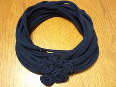 T-shirt scarf with rolled rosettes