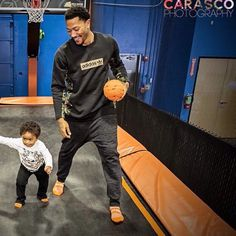 Derrick Rose and son PJ. I'm sure I'll be doing things like this one day...