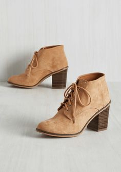 Gigs Galore Bootie. Youve got the chops for a nightly appearance on stage, and now youve found the faux-suede ankle boots thatll make your stage presence all the more spectacular. #tan #modcloth