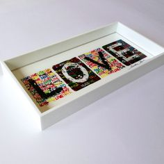 Love is the greatest power on earth!  original artwork & concept by Caroline Rovithi (www.carolinerovithi.com)    plexiglass decorartive tray with original design as result of personal inspiration and totally handmade.  size : 30 cm x 15 cm x 3,5 cm height  Comes in white porcelain, black or transparent plexiglass (choose below)