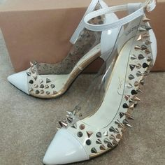 Privileged studded pump This Privileged pump features a white pointed toe, strap and 4 1/2 inch heel. A transparent upper is covered in bold and edgy studs for the perfect look! Privileged Shoes Heels