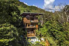 Costa Rica Treehouse / Olson Kundig Completed in 2017 in Playa Hermosa Costa Rica. Images by Nic Lehoux. Costa Rica Treehouse is inspired by the jungle of this densely forested site on the Pacific Coast of Costa Rica. Built entirely of teak wood. Costa Rica, Tiny House, Building A Treehouse, Wood Shutters, Tree Canopy, Surf Shack, Cabana, House And Home Magazine, Inspired Homes