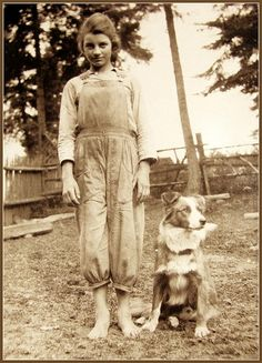 Vintage photo, farm girl and her dog.