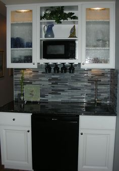 The new Basement Wet Bar!  I pinned a few, started working on it, and this is how it came out.
