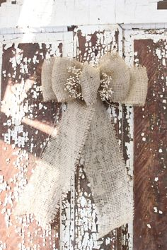 Love this ... would like to incorporate lace too  Burlap wedding/rustic/fall/christmas bow. $7.00, via Etsy. by donnaconnel