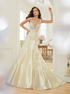 Style Y11551, Swan, is a beautiful taffeta fit and flare wedding dress with chapel train designed by Sophia Tolli, click here for more details.