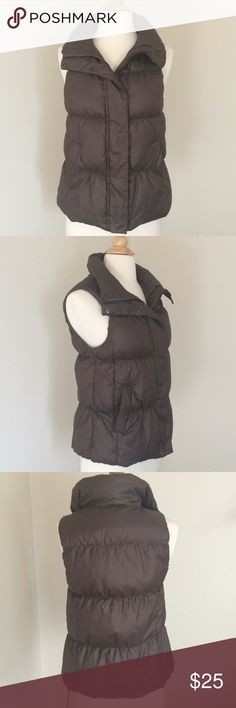 """🍃Gap Down Vest - Brown A pretty vest!  • Labeled XS, runs a bit large • 2 outer pockets, 1 inside  • umber brown color w/enough nice subtle sheen to be sophisticated • In EUC, no tears or color issues  • 75% down/ not thick but looks it  • drawstring for waist is broken (see pic). Can be hidden into grommet, but not functional.  • shoulder 13"""", armpits 17"""", waist 36"""", length 23""""  • wash cold front load washer   Thanks for looking! Please ask any questions before buying. We want you to be…"""