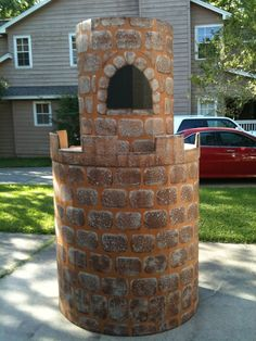 """Top of the tower. All together, the tower will be about 8 feet high. Tower made of heavy, corrugated cardboard surrounding a """"frame"""" made of cardboard boxes. Sponge painted for brick/rock effect."""