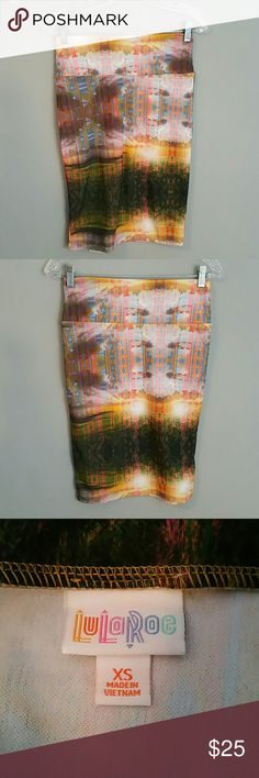LuLaRoe Cassie Skirt In excellent shape. More of a graffiti style pattern. Super cute skirt. Has a lot of stretch in it . LuLaRoe Skirts