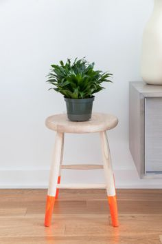 love the pop of color on the legs. cute way to do a side table as well.