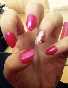 Hot pink gel nails with silver glitter