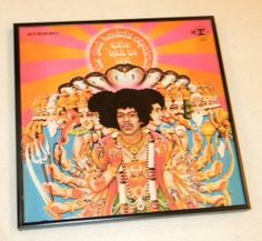 This is an actual vintage album cover containing the original vinyl record album. It has been mounted in a black plastic frame with a glass front and is ready for you to hang on your wall.    Jimi Hendrix Experience - Axis Bold as Love The second of only three studio albums by the Jimi Hendrix Experience, Axis Bold as Love was included on Rolling Stone Magazine's List of the 500 Greatest Albums of All Time.