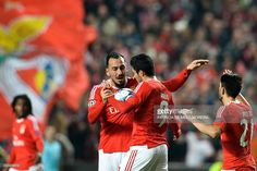 Benfica's Greek forward Konstantinos Mitroglou (L) celebrates with his teammate Benfica's Mexican forward Raul Jimenez after scoring against Atletico de Madrid during the UEFA Champions League Group C football match SL Benfica vs Club Atletico de Madrid at the Luz stadium in Lisbon on December 8, 2015.   AFP PHOTO/ PATRICIA DE MELO MOREIRA / AFP / PATRICIA DE MELO MOREIRA        (Photo credit should read PATRICIA DE MELO MOREIRA/AFP/Getty Images)