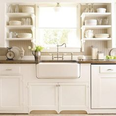 Yes Please, butcher block countertop, farmhouse sink, and tall faucet!