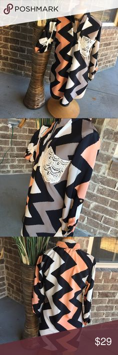 Chevron 3/4 sleeve Beautiful Boutique Style. 100 % polyester Tops Blouses